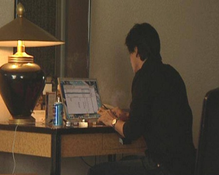 Shahrukh Khan at home on his computer