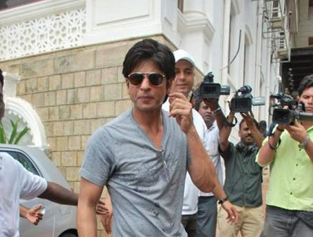 Shahrukh Khan in the compound of his house. Here too he is chased by the press.