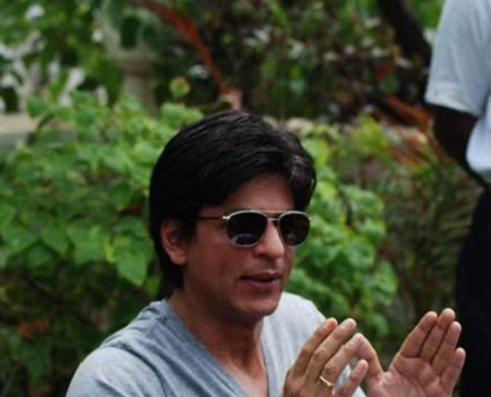 Shahrukh in his garden, addressing the press