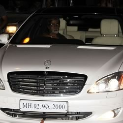 Photo of Amitabh Bachchan driving his Mercedes Benz car.
