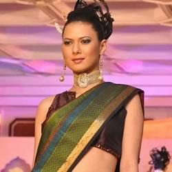 2012 Miss India International Rochele walking the ramp in a traditional sari