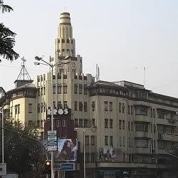 Eros cinema in Bombay is opposite Churchgate station and next to Oval Maidan