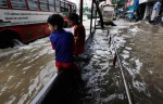 Children climbing on Bus stands to protect against rising water levels in Mumbai's rainy season