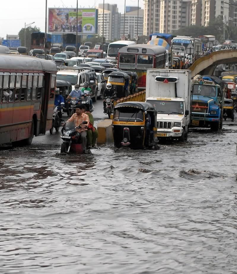 Traffic jam and flood waters during Mumbai's rains. Mumbai's monsoons causes chaos on the roads