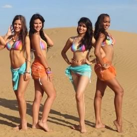 Photo of Miss India, Vanya Mishra, in the official rainbow swimsuit of Miss World 2012.