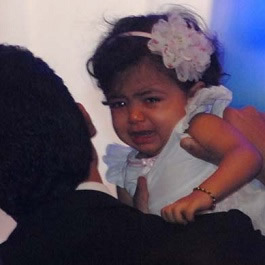 A crying Aaradhya Bachan with her father Abhishek Bachchan during mother Aishwarya's birthday.