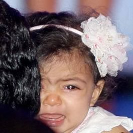 Picture of Aaradhya Bachchan with father Abhishek while mother Aishwarya is awarded France's second highest civilian award.