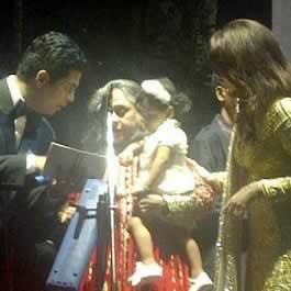 Jaya Bachchan holding granddaughter Aaradhya and with Karan Johar and Aishwarya at Amitabh's 70th Birthday Party.