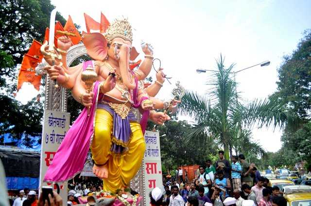 For the 2012 Ganesh Chaturti festival, the Khetwadi 7th Gali Mandal had a large 10 hand Ganpati idol.