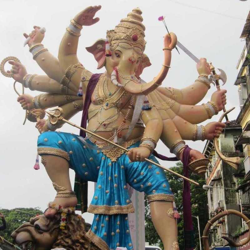 Magnificent 2012 Khetwadi 11th Lane Ganesh Ganraj Mandal Idol. Aggressive 10 handed Ganpati is standing on a lion.