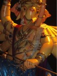 Khetwadi 11 Lane Ganpati has 10 hands, a long trunk and he is standing on a lion.