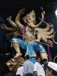 The 2012 Khetwadi 11 Gali Ganesh is standing on a lion. Among Bombay's top Vinayaka Chaturthi statues of 2012