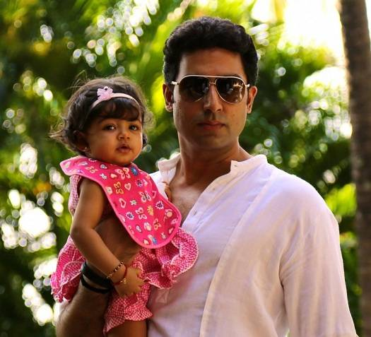 Aaradhya Bachchan, with father Abhishek, at their house Jalsa, on her first birthday.