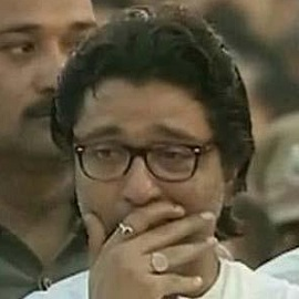 Photo of Raj Thackeray crying at uncle Bal Thackeray's Funeral at Shivaji Park on 18 Nov 2012.