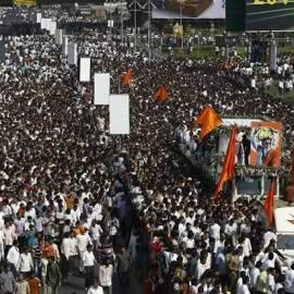 In Mumbai big crowds walked from Matoshri with Balasaheb Thackeray's body for his funeral.