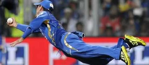 Ricky Ponting dives to take a catch during IPL 6. The 38 year old Mumbai Indian Captain is athletic at his age.