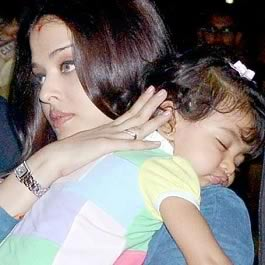 Aradhya Bachchan sleeping in mother Aishwarya's arms.
