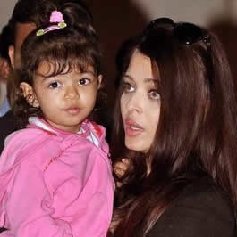 Photo of Aaradhya Bachchan with her mother, Aishwarya Rai. June 2013.
