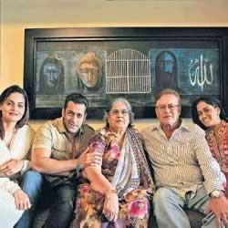 Salman Khan and family inside their Galaxy Apartment House. Painting on the wall is done by Salman Khan.