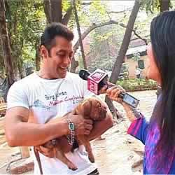 "Salman Khan with his pet dog, ""Veer"", when he was a puppy."