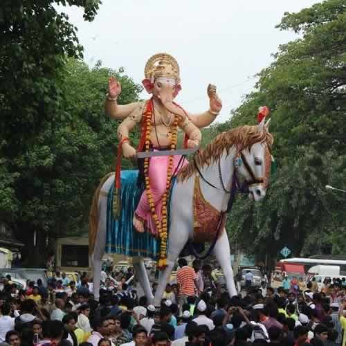 Photo of the 2014 Kamatipuracha Chintamani Ganpati Idol on a horse