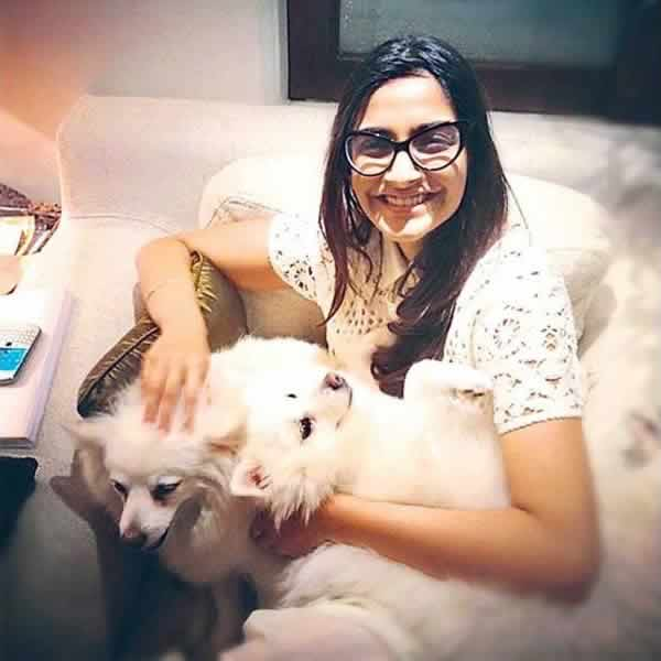 Picture of Actress Sonam Kapoor at home, with her dogs